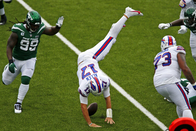 Buffalo Bills quarterback Josh Allen (17) is upended during the first half of an NFL football game against the New York Jets in Orchard Park, N.Y., Sunday, Sept. 13, 2020. (AP Photo/John Munson)