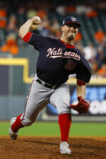 Washington Nationals relief pitcher Tanner Rainey throws against the Houston Astros during the eighth inning of Game 2 of the baseball World Series Wednesday, Oct. 23, 2019, in Houston. (AP Photo/Matt Slocum)