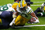 Green Bay Packers running back Aaron Jones (33) dives over the goal line for a touchdown in the second half of an NFL football game against the New Orleans Saints in New Orleans, Sunday, Sept. 27, 2020. (AP Photo/Butch Dill)