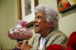 FILE - In this Wednesday, Dec. 30, 2015 file photo, Leah Chase speaks during an interview at her family's restaurant, Dooky Chase's, in New Orleans. The restaurant, which served as a safe meeting space for civil rights activists to strategize, is the site of the first marker to go up on the Louisiana Civil Rights Trail on Monday, May 3, 2021. Chase died in 2019 but her family still owns and operates the restaurant, whose walls are graced by an extensive collection of works by African American artists.  (AP Photo/Gerald Herbert)