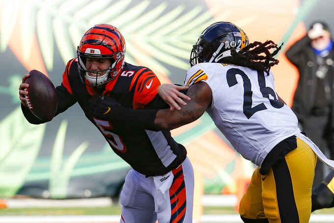 Cincinnati Bengals quarterback Ryan Finley (5) is sacked by Pittsburgh Steelers inside linebacker Mark Barron (26) during the first half an NFL football game, Sunday, Nov. 24, 2019, in Cincinnati. (AP Photo/Frank Victores)