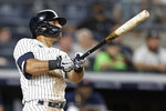 New York Yankees' Rougned Odor watches his 2-run home run during the seventh inning of a baseball game against the Boston Red Sox on Sunday, July 18, 2021, in New York. (AP Photo/Adam Hunger)
