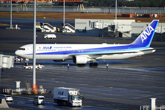 A Japanese chartered plane carrying evacuees from Wuhan, China, landed at Haneda international airport in Tokyo Wednesday, Jan. 29, 2020. Countries on Wednesday began evacuating their citizens from the Chinese city hardest-hit by an outbreak of a new virus. (AP Photo/Eugene Hoshiko)