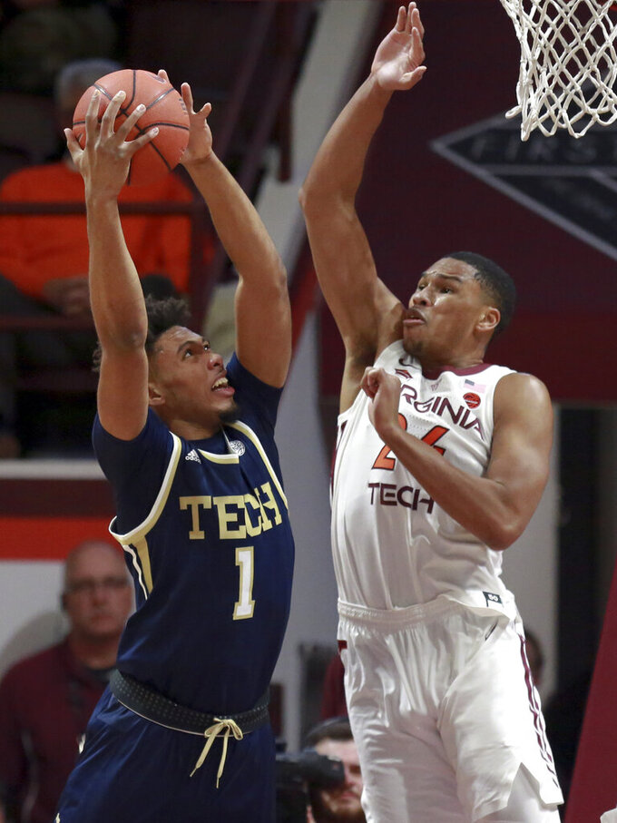 Georgia Tech's James Banks III (1) scores on an offensive rebound past Virginia Tech's Kerry Blackshear Jr. (24) during the first half of an NCAA college basketball game Wednesday, Feb. 13, 2019, in Blacksburg, Va. (Matt Gentry/The Roanoke Times via AP)