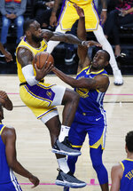 Los Angeles Lakers forward LeBron James, left, is fouled by Golden State Warriors guard Andre Iguodala during the first half of an NBA preseason basketball game Wednesday, Oct. 10, 2018, in Las Vegas. (AP Photo/John Locher)