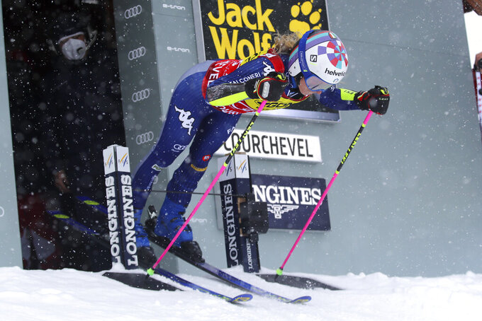 Italy's Marta Bassino prepares to down the course on her way to win an alpine ski, women's World Cup giant slalom in Courchevel, France, Saturday, Dec. 12, 2020. (AP Photo/Marco Trovati)