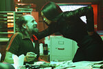 This image released by USA Network shows Peter Stormare as Gunter, left, and Rosario Dawson as Allegra Dill in a scene from her new series