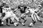 FILE- In this undated file photo, Detroit Lions defensive tackle Alex Karras (71) plays against the Los Angeles Rams. Karras' installment into the Pro Football Hall of Fame should put to rest years of speculation about why he wasn't inducted sooner. (Detroit Lions via AP)