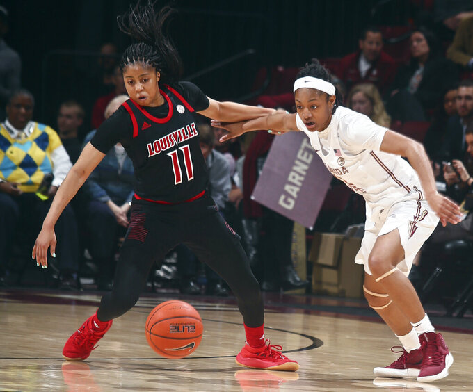 Louisville guard Arica Carter (11) and Florida State guard Nicole Ekhomu (12) go after a loose ball during the fourth quarter of an NCAA college basketball game in Tallahassee, Fla., Thursday, Jan. 24, 2019. (AP Photo/Phil Sears)