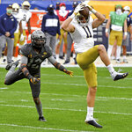Notre Dame wide receiver Ben Skowronek pulls in a pass for a touchdown against Pitt defensive back Paris Ford in the first quarter at Heinz Field Saturday, Oct. 24, 2020, in Pittsburgh. (Matt Freed/Pittsburgh Post-Gazette via AP)