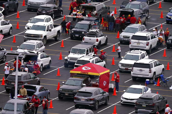 Fans tailgate outside Arrowhead Stadium before the AFC championship NFL football game between the Kansas City Chiefs and the Buffalo Bills, Sunday, Jan. 24, 2021, in Kansas City, Mo. (AP Photo/Charlie Riedel)