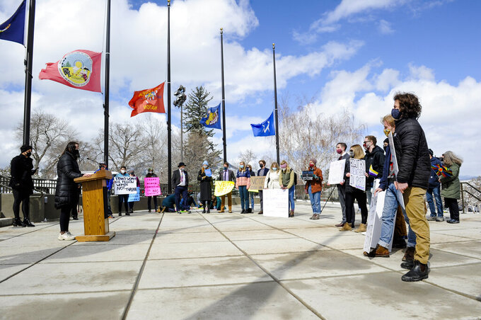 Students, transgender people and allies from across Montana gather in front of the state Capitol in Helena, Mont., on Monday, April 19, 2021, to protest a bill that would ban transgender athletes from competing in school and college sports under the gender with which they identify. (Thom Bridge/Independent Record via AP)