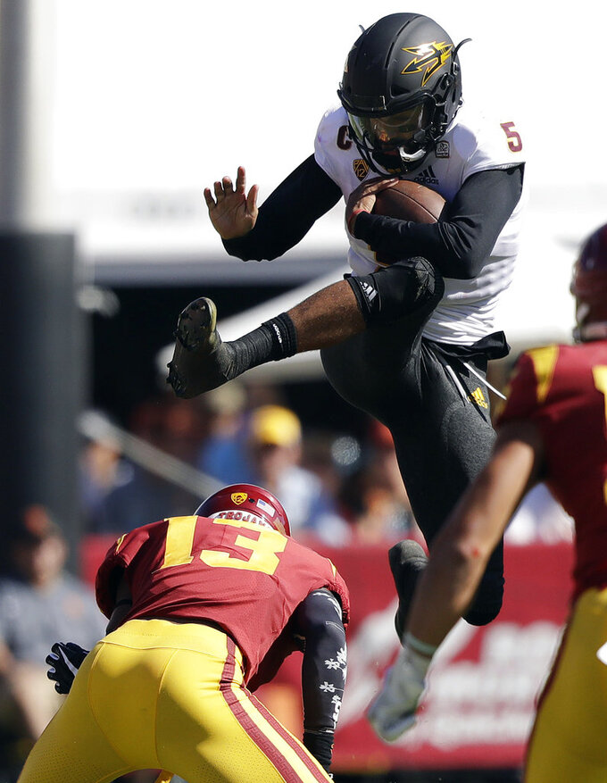 Arizona State quarterback Manny Wilkins, top, leaps over Southern California linebacker Levi Jones (13) during the first half of an NCAA college football game Saturday, Oct. 27, 2018, in Los Angeles. (AP Photo/Marcio Jose Sanchez)