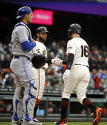 San Francisco Giants' Aramis Garcia (16) is congratulated by Kevin Pillar after hitting a two run home run off Toronto Blue Jays' Edwin Jackson in the second inning of a baseball game Wednesday, May 15, 2019, in San Francisco. At left is Toronto catcher Luke Maile. (AP Photo/Ben Margot)