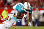 Miami Dolphins wide receiver Preston Williams (82) gets tripped up by Tampa Bay Buccaneers' Tanner Hudson on a punt return during the first half of an NFL preseason football game Friday, Aug. 16, 2019, in Tampa, Fla. (AP Photo/Mark LoMoglio)