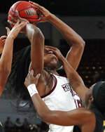 Mississippi State center Teaira McCowan (15) tries to shoot, while Missouri guard Amber Smith, right, puts a hand to her face during the first half of an NCAA college basketball game Thursday, Feb. 14, 2019, in Starkville, Miss. (AP Photo/Rogelio V. Solis)