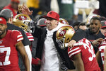 San Francisco 49ers head coach Kyle Shanahan, center, celebrates with players during the second half of the NFL NFC Championship football game against the Green Bay Packers Sunday, Jan. 19, 2020, in Santa Clara, Calif. The 49ers won 37-20 to advance to Super Bowl 54 against the Kansas City Chiefs. (AP Photo/Tony Avelar)