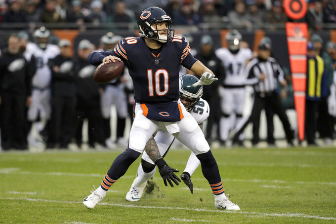 Chicago Bears quarterback Mitchell Trubisky (10) throws under pressure from Philadelphia Eagles defensive end Chris Long (56) during the first half of an NFL wild-card playoff football game Sunday, Jan. 6, 2019, in Chicago. (AP Photo/Nam Y. Huh)