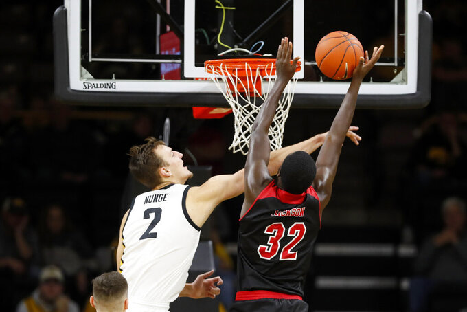 SIU-Edwardsville forward Brandon Jackson (32) is fouled by Iowa forward Jack Nunge (2) while driving to the basket during the first half of an NCAA college basketball game, Friday, Nov. 8, 2019, in Iowa City, Iowa.(AP Photo/Charlie Neibergall)