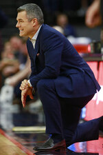 Virginia head coach Tony Bennett watches play during the first half of an NCAA college basketball game against Syracuse in Charlottesville, Va., Saturday, Jan. 11, 2020. (AP Photo/Steve Helber)