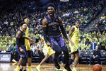 CORRECTS SPELLING OF JAYLEN NOWELL - Washington's Jaylen Nowell (5) celebrates a dunk against Oregon during an NCAA college basketball game Thursday, Jan. 24, 2019, in Eugene, Ore. (AP Photo/Thomas Boyd)