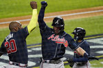 Atlanta Braves' Dansby Swanson celebrates after a home run with Marcell Ozuna against the Los Angeles Dodgers during the second inning in Game 7 of a baseball National League Championship Series Sunday, Oct. 18, 2020, in Arlington, Texas. (AP Photo/Tony Gutierrez)