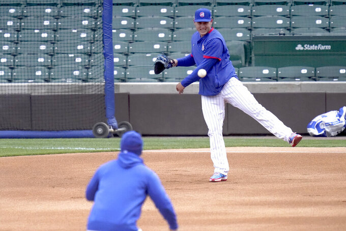Chicago Cubs first baseman Anthony Rizzo throws to Manager David Ross at second, during the team's last baseball workout Wednesday, March 31, 2021, before the home opener Thursday, April 1, 2021, against the Pittsburgh Pirates in Chicago. (AP Photo/Charles Rex Arbogast)