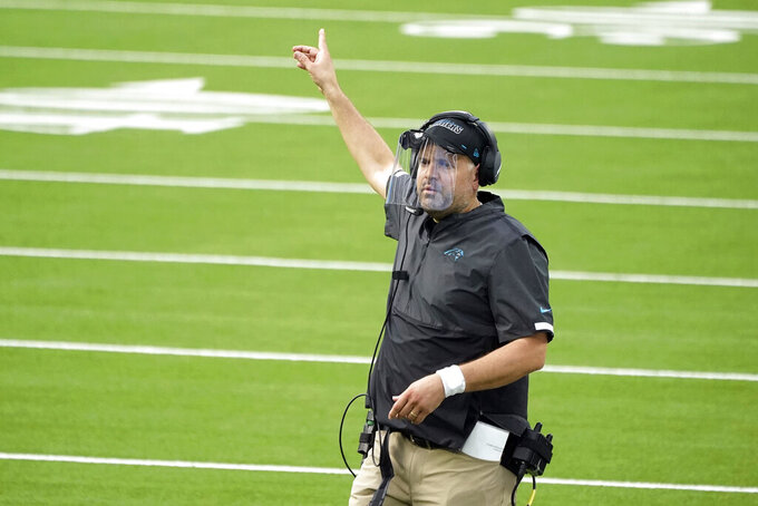 Carolina Panthers head coach Matt Rhule signals during the second half of an NFL football game against the Los Angeles Chargers Sunday, Sept. 27, 2020, in Inglewood, Calif. (AP Photo/Alex Gallardo)