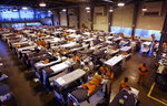 FILE - In this May 20, 2009 file photo, several hundred inmates crowd the gymnasium at San Quentin prison in San Quentin, Calif. A decade after prison crowding forced California to realign its criminal justice system, the population has shrunk to the point that officials on Tuesday, April 13, 2021, announced they will close one of the state's two inmate firefighter training centers along with portions of two other prisons, the second such announcement in months. (AP Photo/Eric Risberg, File)