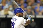 Kansas City Royals' Hanser Alberto hits a two-run single during the fourth inning of a baseball game against the Oakland Athletics Wednesday, Sept. 15, 2021, in Kansas City, Mo. (AP Photo/Charlie Riedel)