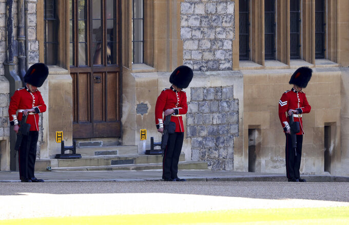 Members of the military line the Quadrangle as they wait the arrival of the coffin carrying The Duke of Edinburgh, ahead of his funeral at Windsor Castle, Windsor, England, Saturday April 17, 2021. Prince Philip died April 9 at the age of 99 after 73 years of marriage to Britain's Queen Elizabeth II. (Johnathan Buckmaster/Pool via AP)