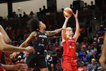 Washington Mystics center Emma Meesseman shoots against Las Vegas Aces forward Tamera Young during the first half of Game 2 of a WNBA playoff basketball series Thursday, Sept. 19, 2019, in Washington. (AP Photo/Nick Wass)