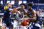 Villanova guard Justin Moore (5) makes a steal from Butler forward Bryce Nze (10) in the second half of an NCAA college basketball game in Indianapolis, Sunday, Feb. 28, 2021. (AP Photo/Michael Conroy)