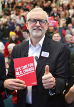 Labour Leader Jeremy Corbyn gestures after addressing a members' rally at Bangor University, while on the General Election campaign trail in Bangor, Wales, Sunday, Dec. 8, 2019. Britain goes to the polls on Dec. 12. (Ben Birchall/PA via AP)