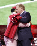 "FILE - In this April 25, 2019, file photo, Oklahoma quarterback Kyler Murray embraces NFL Commissioner Roger Goodell after the Arizona Cardinals selected Murray in the first round at the NFL football draft in Nashville, Tenn. NFL vice president Troy Vincent has sent a letter to several prospects inviting them to participate ""live"" in the NFL draft in three weeks. In recent drafts, first-round selections were announced by Commissioner Goodell. Then followed hugs involving players and Goodell — some of them comical — and photo sessions with the players wearing team ball caps or even showing off team jerseys. This year, with all public events at the planned site of Las Vegas canceled and the draft set to proceed remotely, players will likely be at their homes when their names are called. (AP Photo/Mark Humphrey, File)"