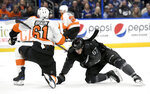 Philadelphia Flyers defenseman Justin Braun (61) and Tampa Bay Lightning center Mitchell Stephens (67) get tangled during the second period of an NHL hockey game Saturday, Feb. 15, 2020, in Tampa, Fla. (AP Photo/Jason Behnken)