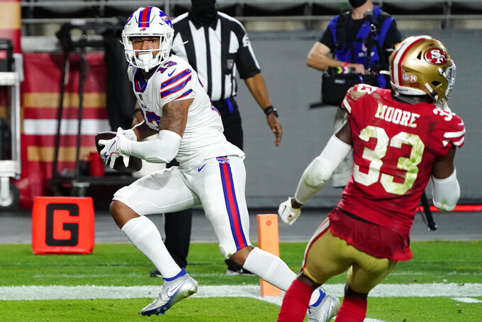 Buffalo Bills wide receiver Gabriel Davis (13) scores a touchdown as San Francisco 49ers defensive back Tarvarius Moore (33) defends during the second half of an NFL football game, Monday, Dec. 7, 2020, in Glendale, Ariz. (AP Photo/Rick Scuteri)