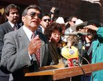 FILE - In this Feb. 19, 1998, file photo, then newly sworn-in Navajo Nation President Thomas Atcitty, second from left at podium, speaks to the Navajo Nation for the first time as their new leader, as former President Albert Hale, left, looks on in front of the Navajo Nation Council Chambers in Window Rock, Ariz. Atcitty, a former interim Navajo Nation president and longtime New Mexico state representative has died. The tribe says Thomas Atcitty died Sunday, Oct. 11, 2020, of natural causes. He was 86. Funeral services are scheduled Wednesday ,Oct. 14, in Shiprock, New Mexico, where Atcitty lived most of his life. (Donovan Quintero/Gallup Independent via AP, File)