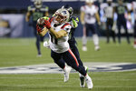 New England Patriots wide receiver Julian Edelman makes a diving catch in front of Seattle Seahawks strong safety Jamal Adams during the second half of an NFL football game, Sunday, Sept. 20, 2020, in Seattle. (AP Photo/John Froschauer)