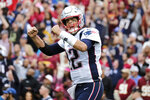 New England Patriots quarterback Tom Brady (12) reacts to a touchdown against the Washington Redskins during the second half of an NFL football game, Sunday, Oct. 6, 2019, in Washington. (AP Photo/Mark Tenally)