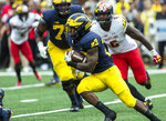 Michigan running back Karan Higdon (22) rushes in the second quarter of an NCAA college football game against Maryland in Ann Arbor, Mich., Saturday, Oct. 6, 2018. (AP Photo/Tony Ding)