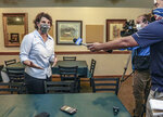 Democratic Kentucky Senate candidate Amy McGrath talks to the media during a stop at Moonlite Bar-B-Q Inn, Saturday, Aug. 1, 2020, in Owensboro, Ky, during a kickoff of her voter registration initiative, part of her statewide tour to register voters.(Greg Eans/The Messenger-Inquirer via AP)