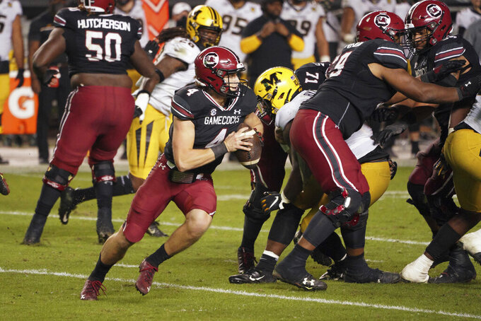South Carolina quarterback Luke Doty (4) scrambles from the pocket during the second half of an NCAA college football game against Missouri, Saturday, Nov. 21, 2020, in Columbia, S.C. (AP Photo/Sean Rayford)