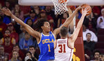 Southern California forward Nick Rakocevic, right, shoots as UCLA center Moses Brown defends during the second half of an NCAA college basketball game Saturday, Jan. 19, 2019, in Los Angeles. USC won 80-67. (AP Photo/Mark J. Terrill)