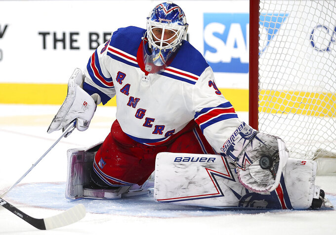 FKILE - In this Oct. 30, 2018, file photo, New York Rangers goalie Henrik Lundqvist makes a save in overtime during an NHL hockey game against the San Jose Sharks, in San Jose, Calif. The New York Rangers have bought out the contract of star goaltender Henrik Lundqvist. The Rangers parted with one of the greatest netminders in franchise history on Wednesday, Sept. 30, 2020, when they paid off the final year of his contract.(AP Photo/Ben Margot, File)