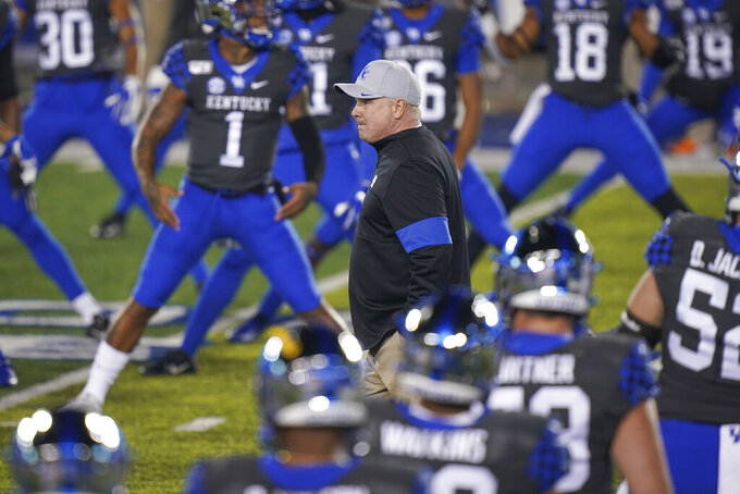 Kentucky coach Mark Stoops walks on the field prior to an NCAA college football game against Tennessee, Saturday, Nov. 9, 2019, in Lexington, Ky. (AP Photo/Bryan Woolston)