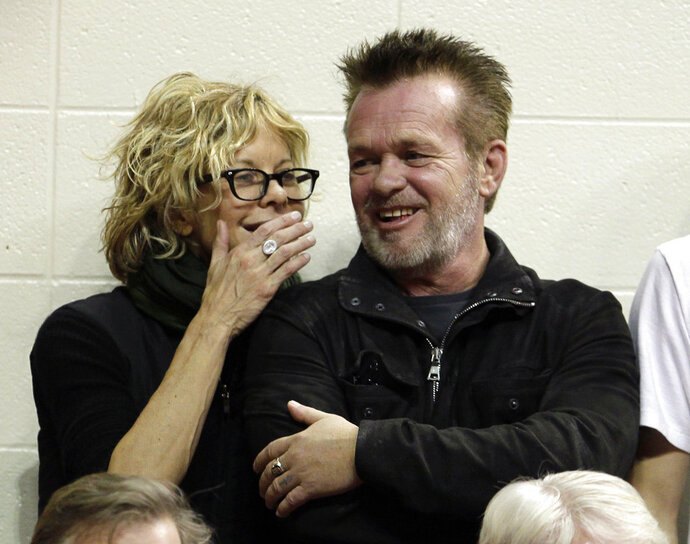 "FILE - In this Dec. 31, 2011 file photo, Actress Meg Ryan, left, talks with performer John Mellencamp during the second half of an NCAA college basketball game between Indiana and Ohio State in Bloomington, Ind.  Mellencamp and Ryan are getting married. Ryan announced her engagement on Instagram. ""ENGAGED!,"" is what she wrote. The post included a drawing of what appears to be the two holding hands. He's also holding a guitar. (AP Photo/Darron Cummings, File)"
