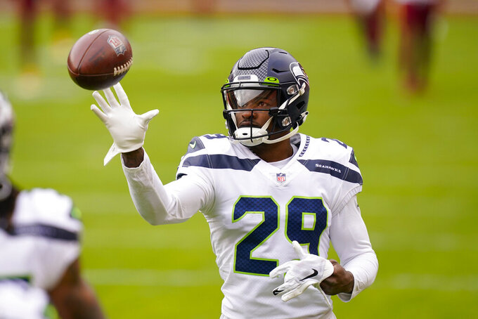 Seattle Seahawks free safety D.J. Reed (29) catching a ball before the start of an NFL football game against the Washington Football Team, Sunday, Dec. 20, 2020, in Landover, Md. (AP Photo/Andrew Harnik)