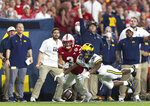 Michigan defensive back Daxton Hill (30) knocks away a pass intended for Nebraska wide receiver Samori Toure (3) on fourth down in the final minute of an NCAA college football game Saturday, Oct. 9, 2021, in Lincoln, Neb. (AP Photo/Rebecca S. Gratz)