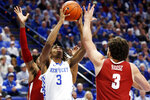 Kentucky's Tyrese Maxey (3) shoots between Alabama's John Petty Jr., left, and Alex Reese during the second half of an NCAA college basketball game in Lexington, Ky., Saturday, Jan 11, 2020. Kentucky on 76-67. (AP Photo/James Crisp)